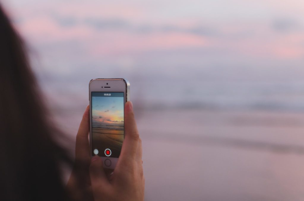 holding-phone-taking-video-of-view