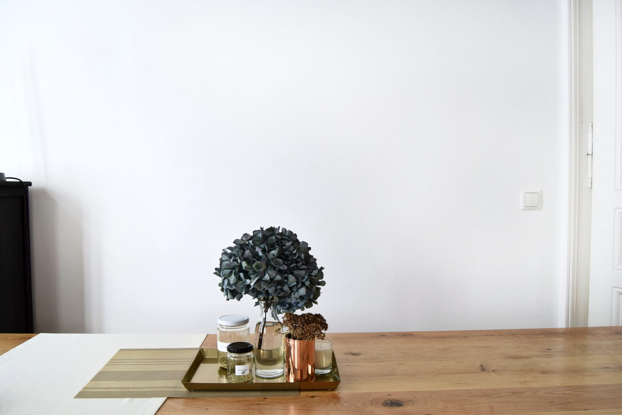 table-tray-flowers-jars-white-wall