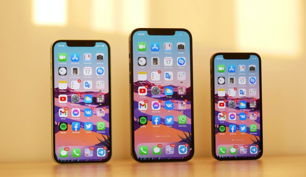 Three smartphones with homescreens showing different apps