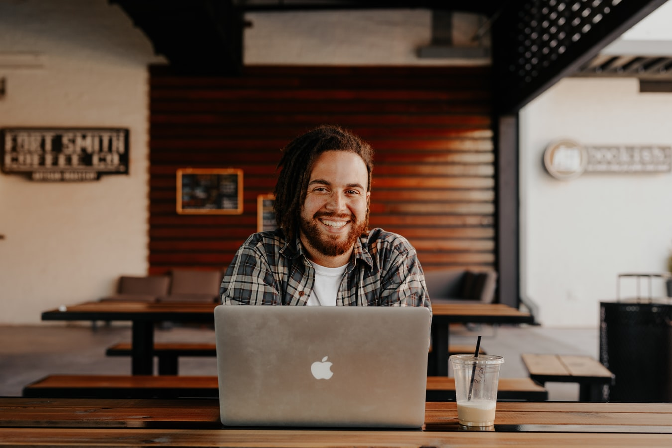 Smiling man sitting at his laptop