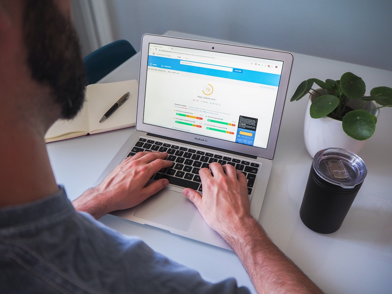 Man on laptop using PPC to upstage his competition